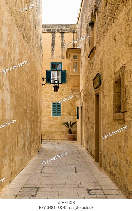 A narrow street in the historical medieval city of Mdina on Malta