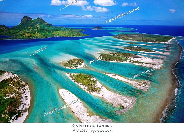 An aerial view over Mount O'Temanu and the barrier reef in Bora Bora, Tahiti