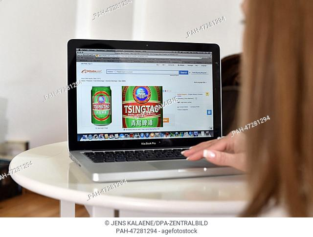 ILLUSTRATION - A young woman browses on her notebook computer through the web page of Chinese online retailer Alibaba looking at Chinese beer on sale in Berlin