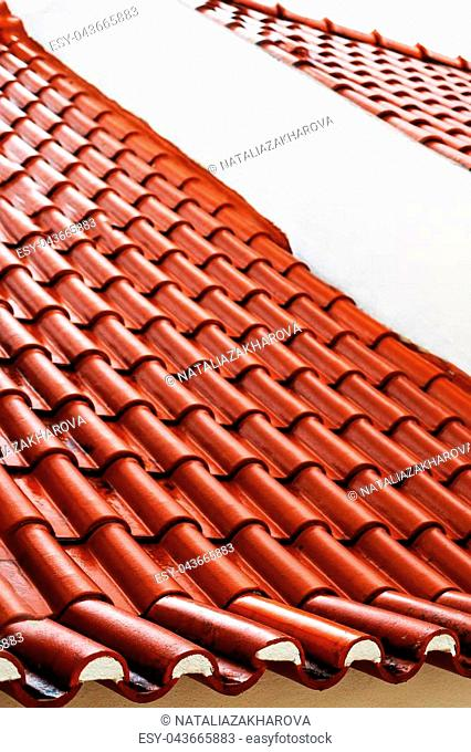 Red color roof tiles isolated with copyspace