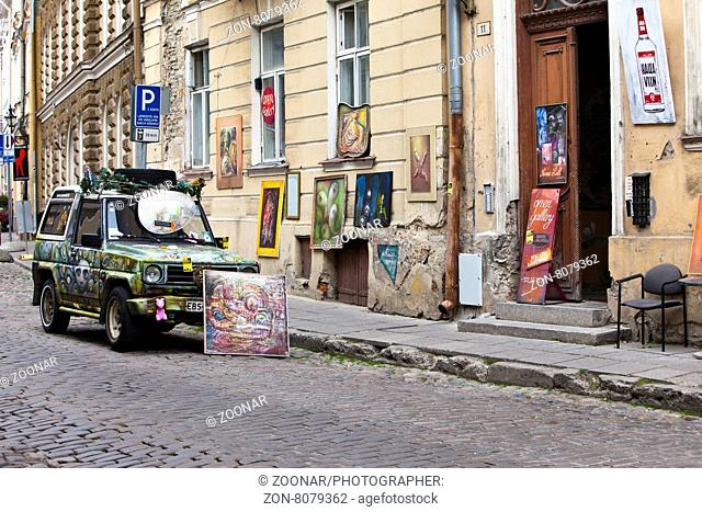 TALLINN, ESTONIA- JUNE 16: Brightly decorated car advertizes an input in art gallery in the Old city on June 16, 2012 in Tallinn, Estonia