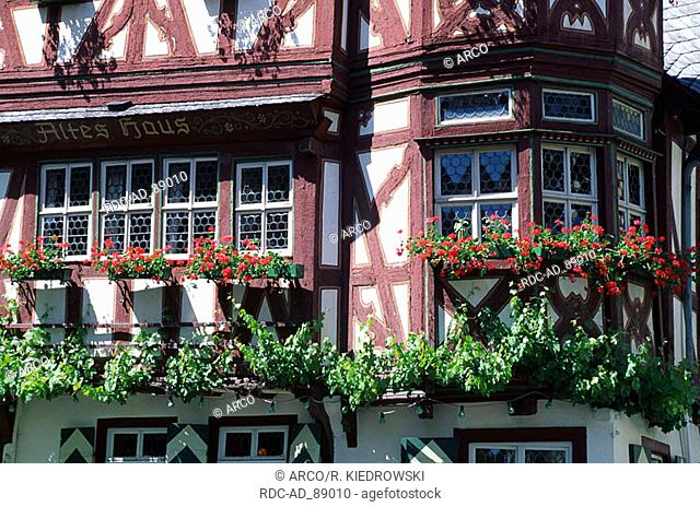 Timber-framed house 'Altes Haus' with flower decoration Bacharach Rhineland-Palatinate Germany UNESCO World Cultural Heritage Mittelrheintal
