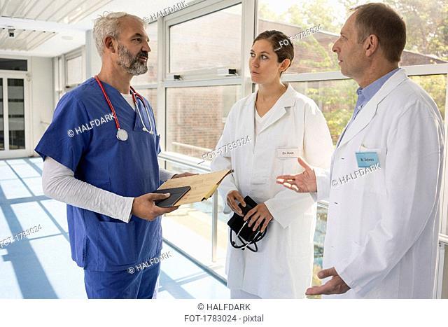 Doctors talking in hospital corridor