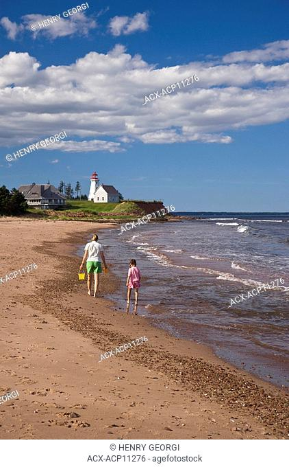 Young woman with daughter explore beach on Panmure Island, Points East Scenic Route, Prince Edward Island, Canada