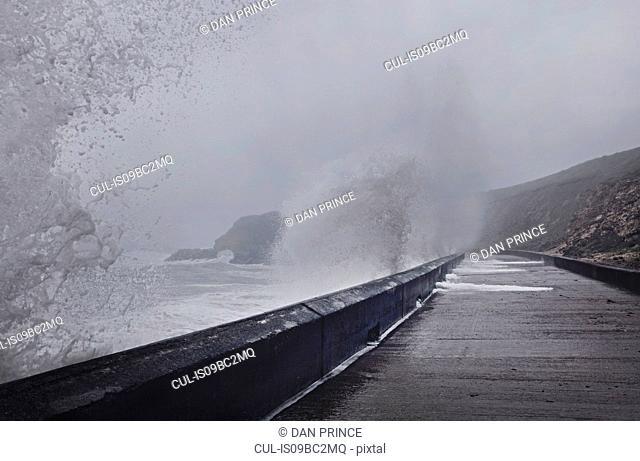 Water crashing against sea wall, Seaham Harbour, Durham, UK