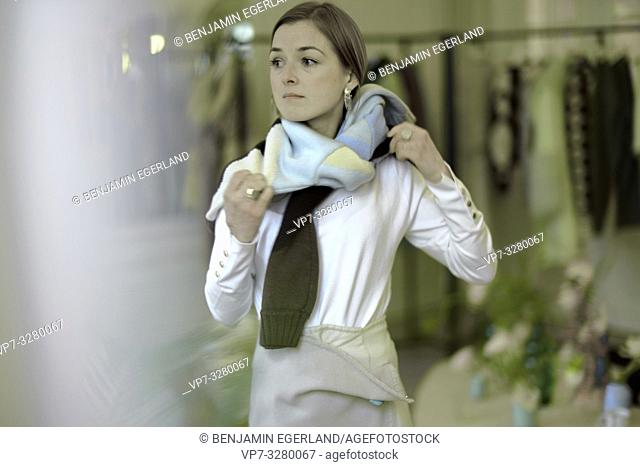 stylish woman trying latest fashion trends in private showroom during fashion week, in Paris, France