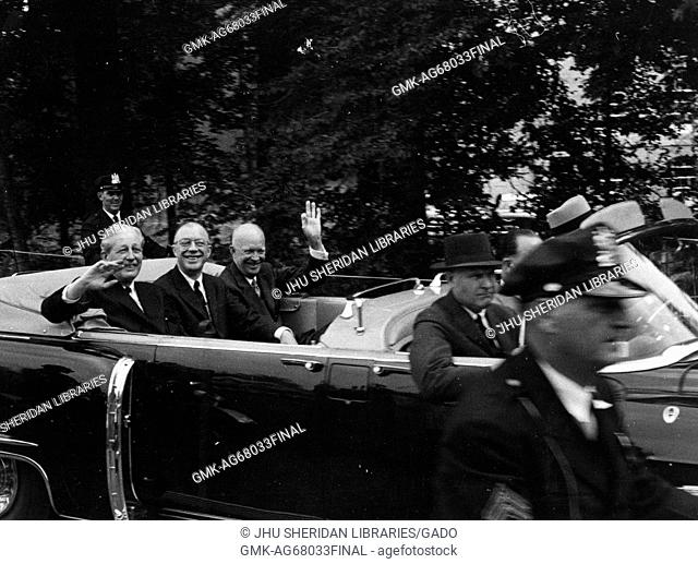 Milton Stover Eisenhower (center), president of Johns Hopkins University, in the backseat of a car with former Prime Minister of the United Kingdom Harold...