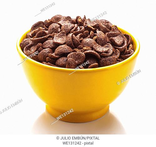 yellow bowl full of cereal with chocolate
