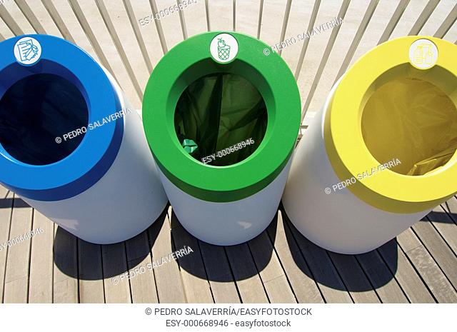 three bins for recycling paper, glass and organic materials