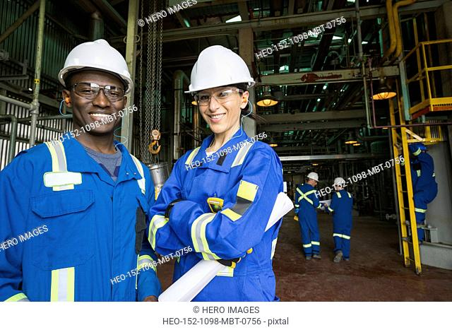 Portrait of confident workers in gas plant