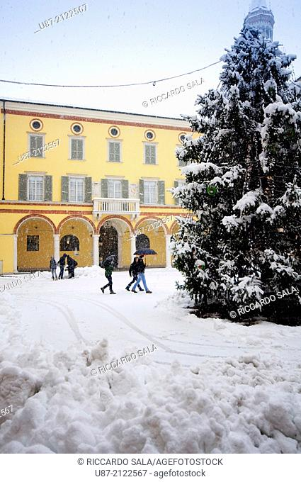 Italy, Lombardy, Crema, Piazza Duomo Square, Christmas Trees background Palazzo Vescovile