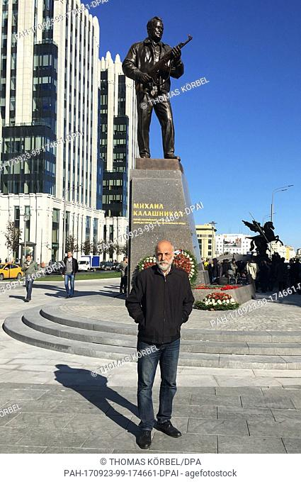 Russian artist Salavat Shcherbakov next to a memorial in honour of the Soviet weapon designer Mikhail Kalashnikov inMoscow,Russia, 22 September 2017