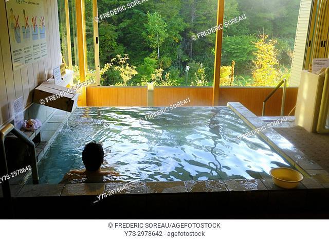 Japanese man relaxing in bath or onset, Takayama, Japan, Asia