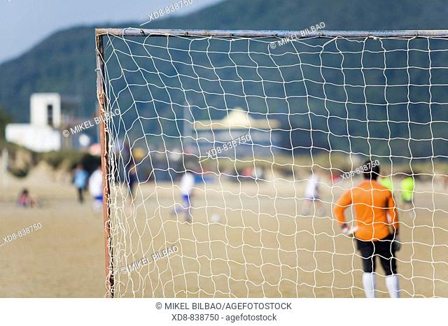 net and goalkeeper in a football goal