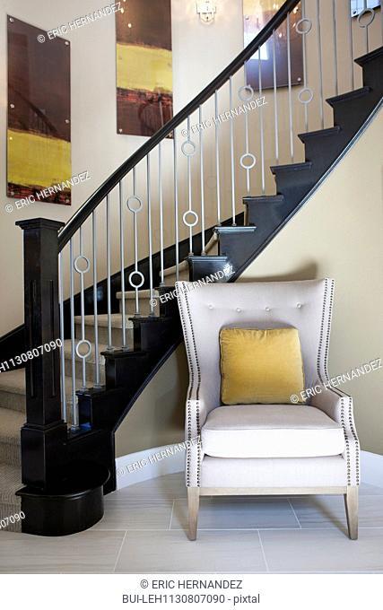 Arm chair against staircase; Valencia; California; USA