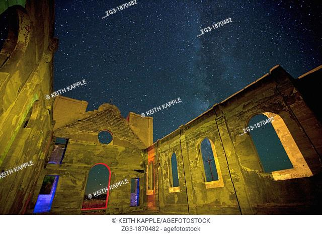 Old ruined mission at night with the Milky Way showing in southern Colorado, USA