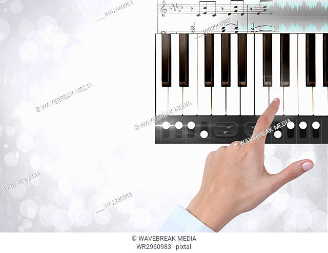 Hand Touching Piano keys with notes and effects App Interface