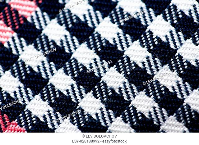 textile and texture concept - close up of checkered fabric background