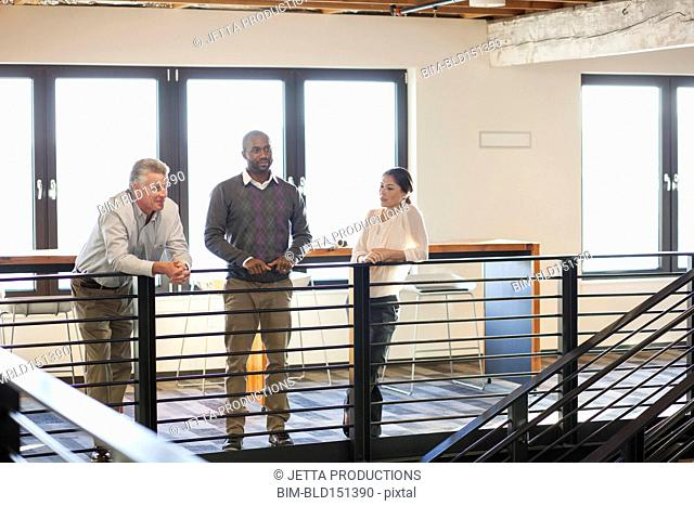 Business people talking near staircase