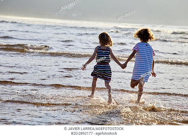 Girls playing on the beach, Zarautz, Gipuzkoa, Basque Country, Spain, Europe