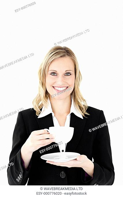 Businesswoman with cup of coffee against white background