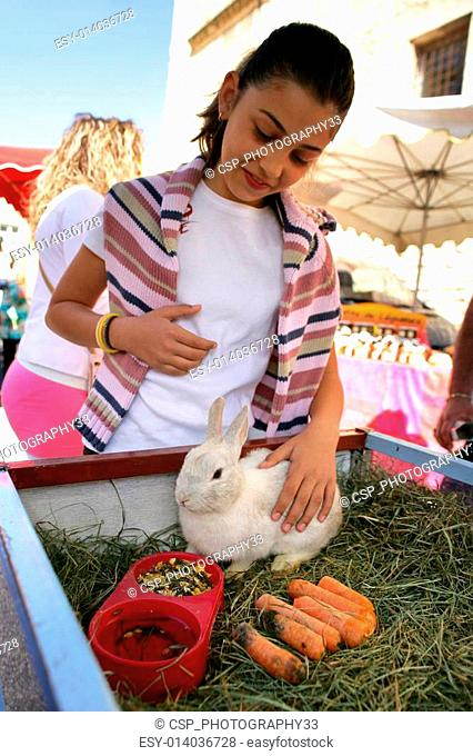 Woman petting a rabbit