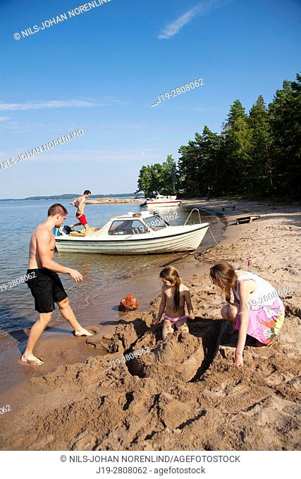 Family building sand castle, Swedish archipelago