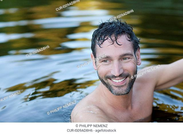 Portait of mature man in lake