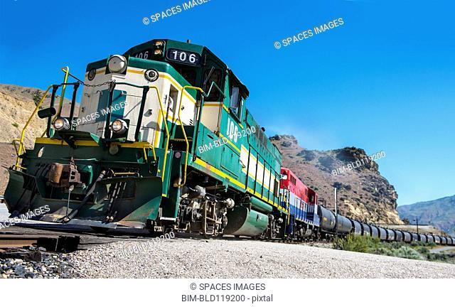Train on tracks in rural landscape