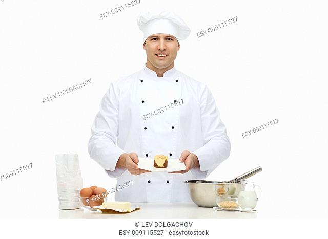 cooking, profession, haute cuisine, food and people concept - happy male chef cook baking dessert