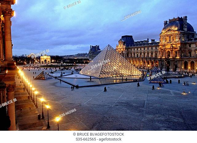 The night view of Cour Napoleon of Musee Louvre from Denon Wing. Paris. France