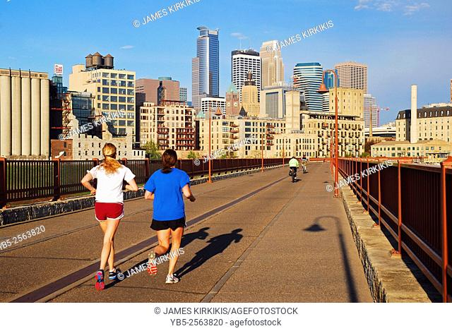 Joggers on a Sunny Day on the Stone Arch Bridge in Minneapolis
