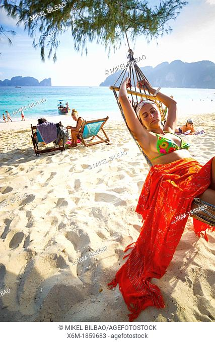 Young woman relaxing on a hammock  Long beach  Phi Phi Don island  Krabi province, Andaman Sea, Thailand