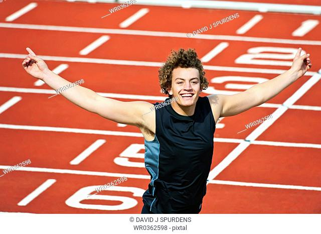 Happy Athlete crossing the winning line