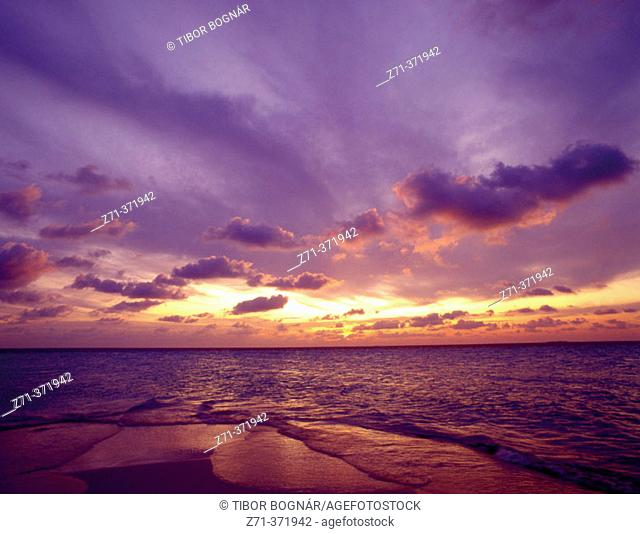 Beach, clouds and sea at sunset, Maldives
