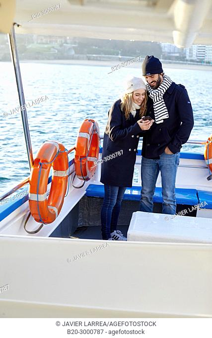 Couple on a boat trip to Santa Clara Island, La Concha Bay, Donostia, San Sebastian, Gipuzkoa, Basque Country, Spain, Europe, Winter