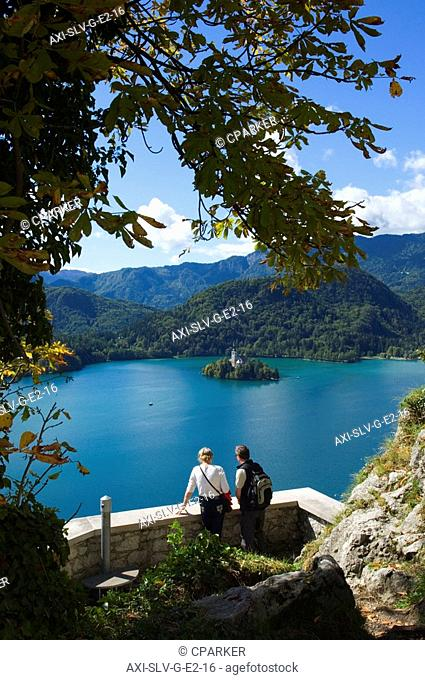 Two tourists looking at Lake Bled from castle, Slovenia