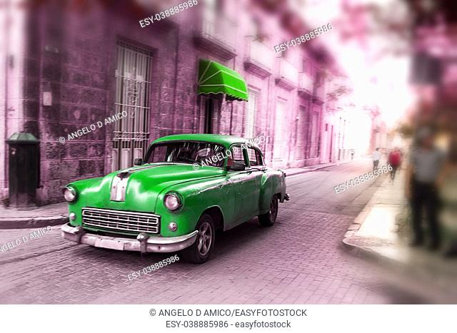 Green, old american classical car in road of old Havana (Cuba)