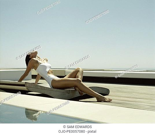 A woman relaxing poolside