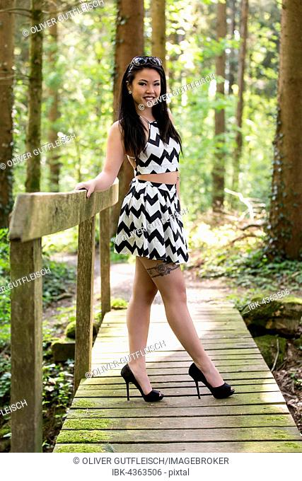 Young Asian woman in black and white dress, fashion