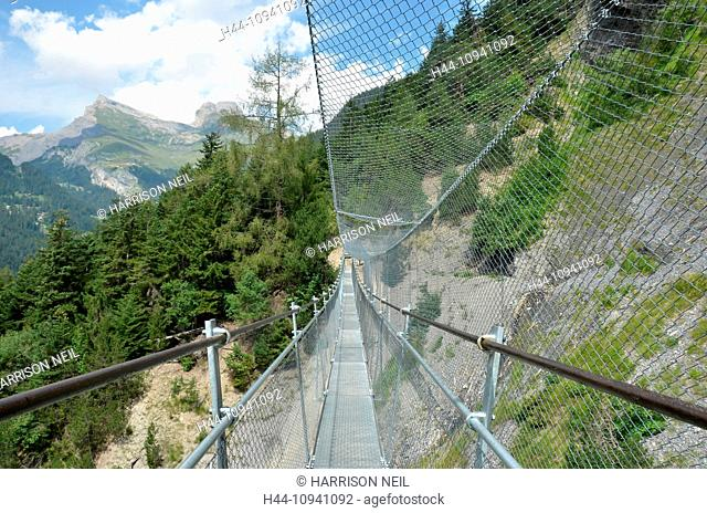 A steel suspension in the mountains for pedestrians, with steel netting to protect them from rock falls