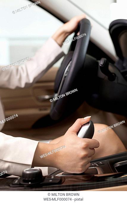 At the car dealer, Woman inside new car, close-up