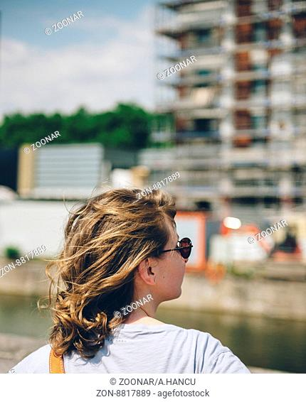 Woman admiring her dream apartment house