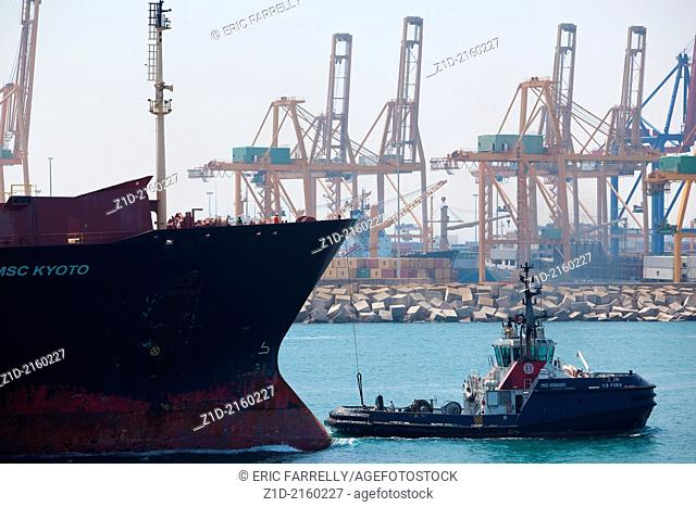 """Container ship """"""""MSC KYOTO """""""" entering Valencia harbour Spain with tugs assisting"""