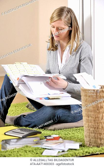 Woman with tax records