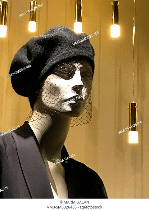 Mannequin wearing hat with veil in a shop window. Serrano street, Madrid, Spain