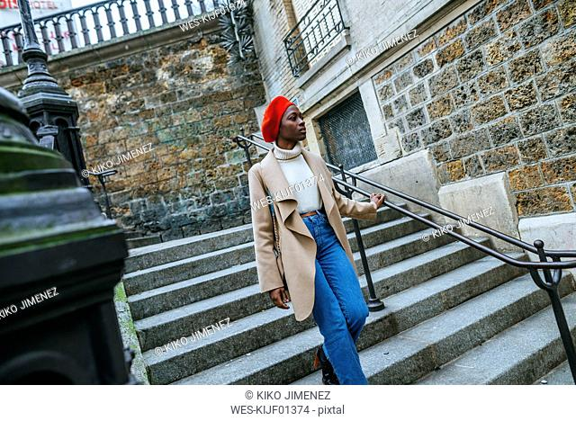 Young woman in Paris walking on stairs