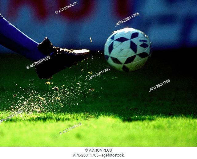 Football player kick a ball
