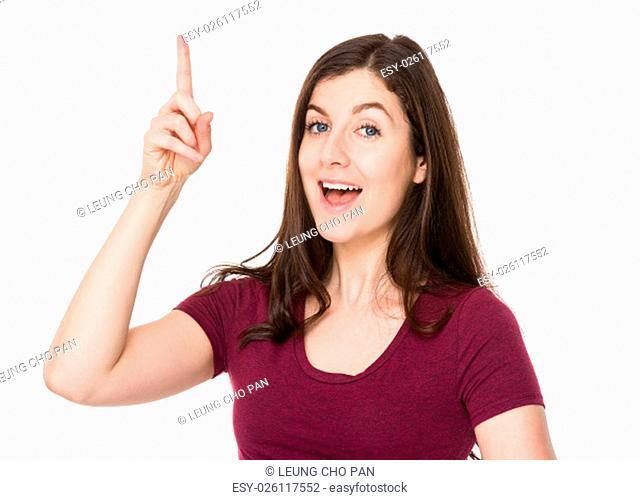 Brunette woman finger point up