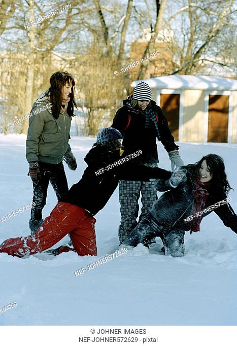 Four teenage girls playing in the winter, Sweden
